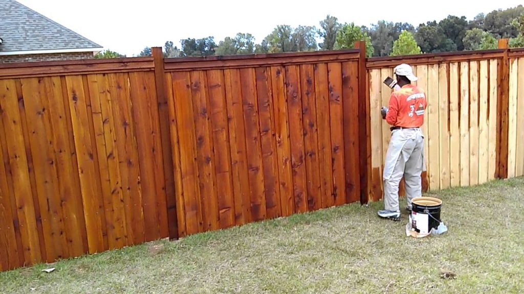 wood fence installation and stain